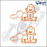 "STICK FAMILY BABY PLAYING WITH ALLIGATOR   2.5"" DECAL"