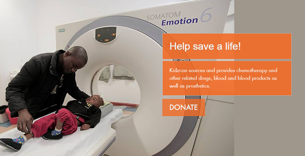 Man standing next to a child with cancer on a MRI bed in Zimbabwe