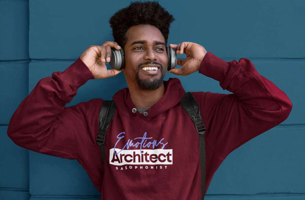 Black man with headphones and backpack wearing a hoodie with emotions architect saxophonist design by Ryan Koriya