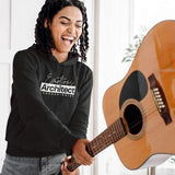 Percussionist Hoodie for Musicians - Smiling woman holding an acoustic guitar pretending to throw it to the ground