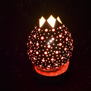 Small table lamp made of carved beaded pumpkin.
