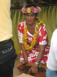 Tahitian Mama making Monoi Oil with her hands, Papeete, Tahiti