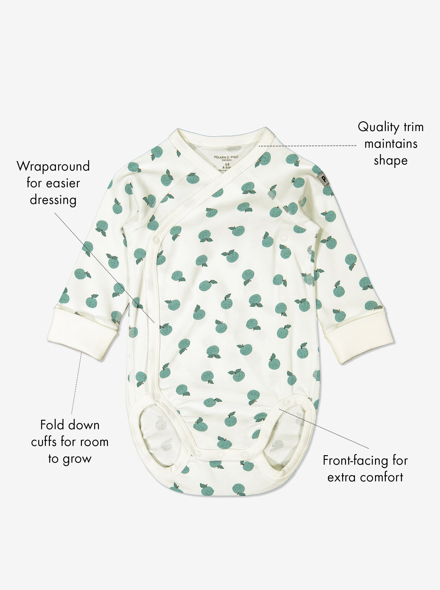 GOTS organic cotton long sleeve newborn babygrow in a unisex apple print with text labels shown on the sides