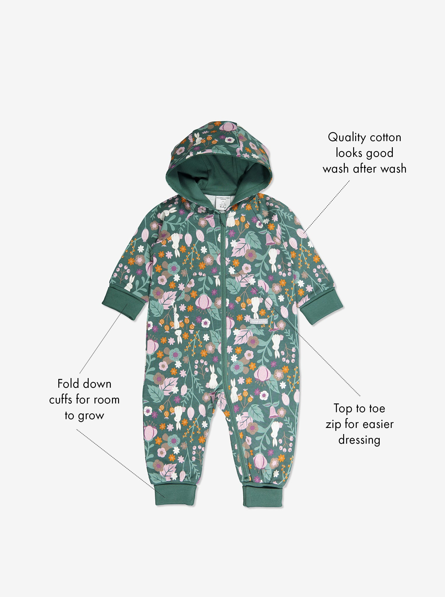 GOTS organic cotton baby all-in-one in a woodland print with text labels shown on the sides