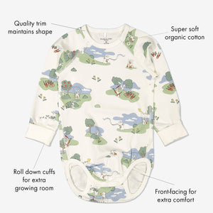 GOTS organic cotton long sleeve babygrow in a unisex bunny print with text labels shown on the sides