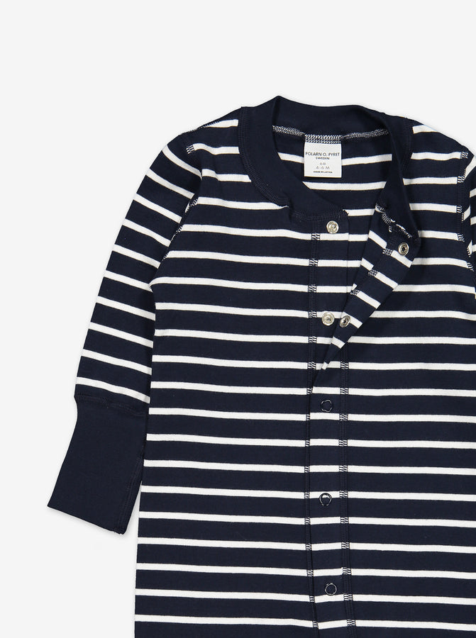 Top area of the striped baby all-in-one ni navy blue and white colour, with the top buttons unlocked.