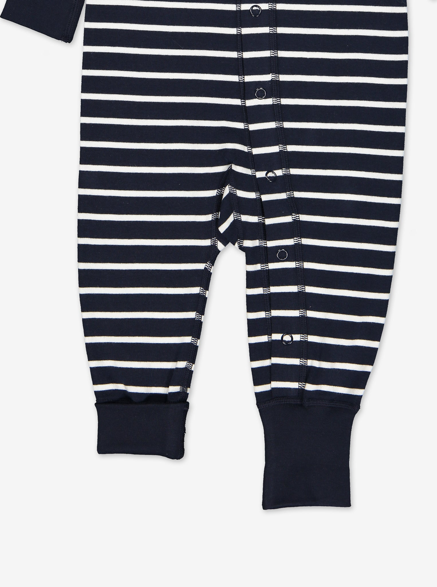 Bottom area of an all-in-one babysuit in the colour navy blue and white, made from organic cotton material.