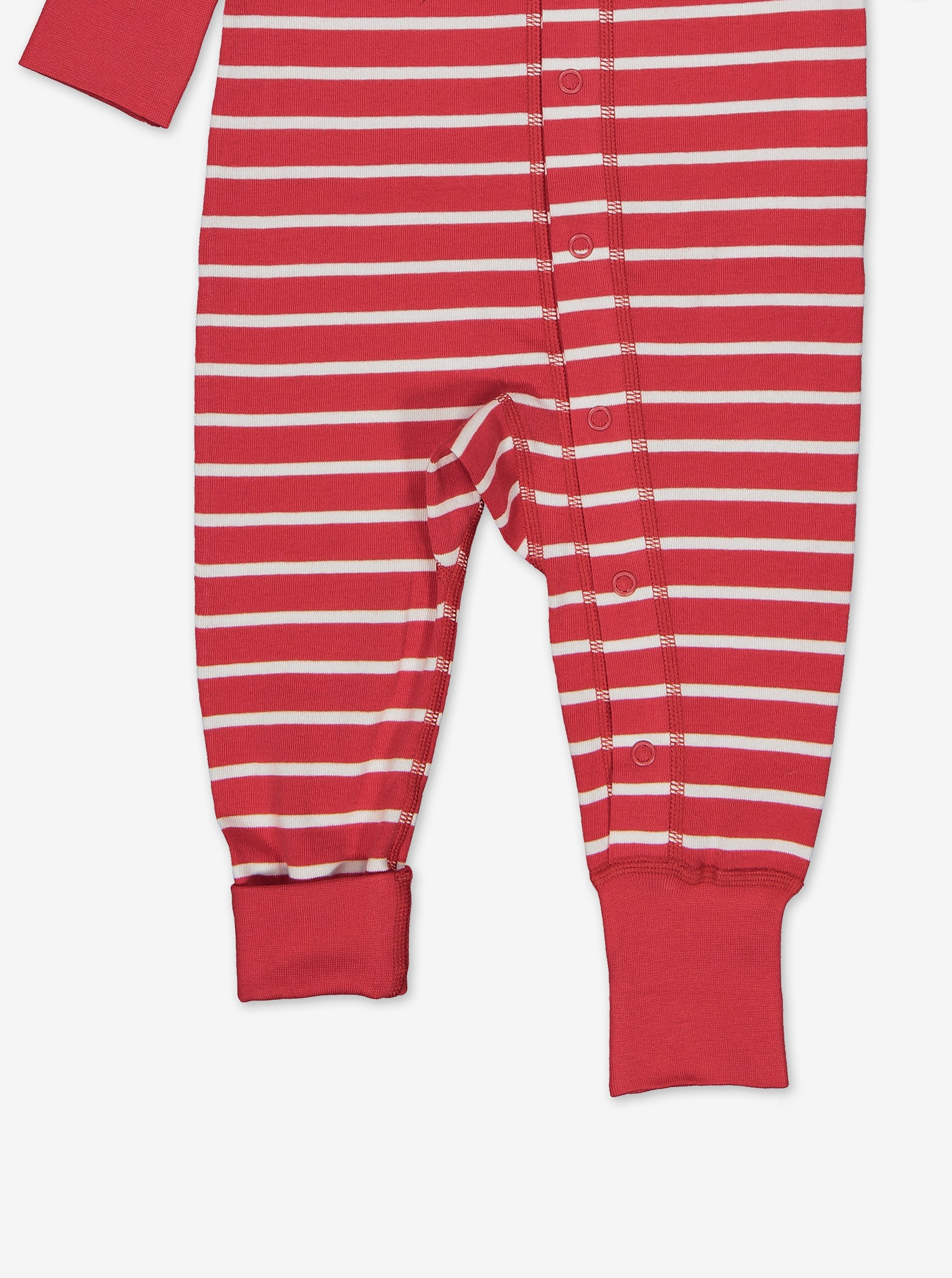 Leg area of the red and white stripe print baby all-in-one, showing the left leg cuffs folded and the right cuff unfolded.