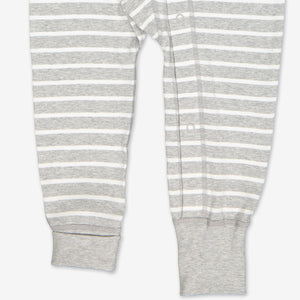 Bottom leg area of a baby all-in-one in a classic grey and white stripe print, showing poppers at the ankle.