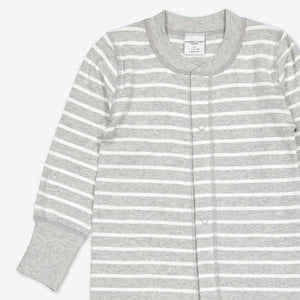 Top half of a grey and white stripe print baby all-in-one, made from organic cotton featuring roll down cuffs and poppers.
