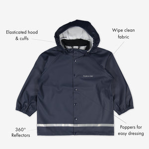 Navy, kids waterproof raincoat, made with shell fabric, includes elastic cuffs, detachable hood, reflectors & popper buttons.