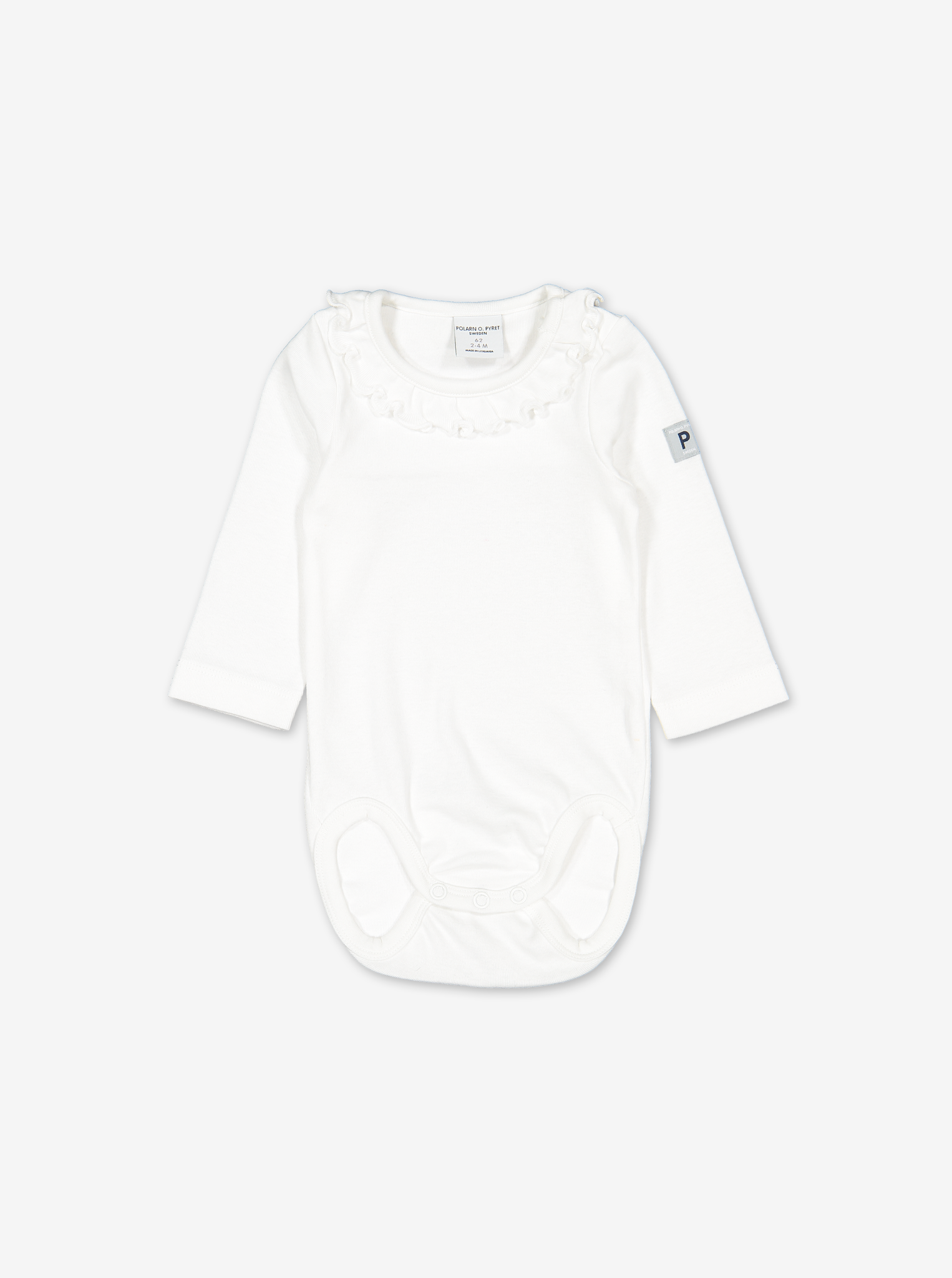 Front view of a white ruffled organic baby grows for babies and toddlers, made with 100% organic cotton.