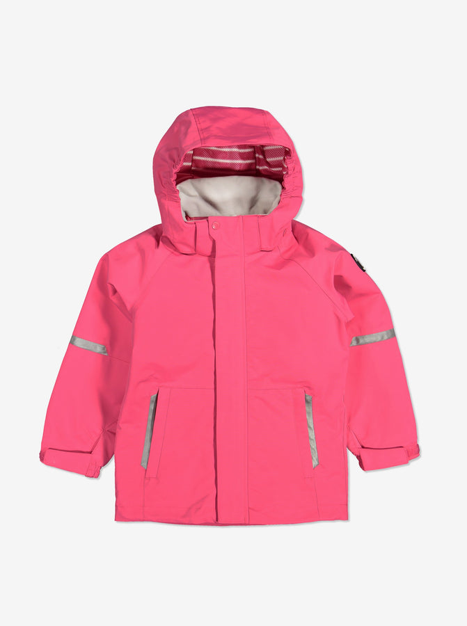 Pink, kids waterproof jacket, with detachable hood, reflectors, adjustable cuffs and front pockets, made of shell fabric.