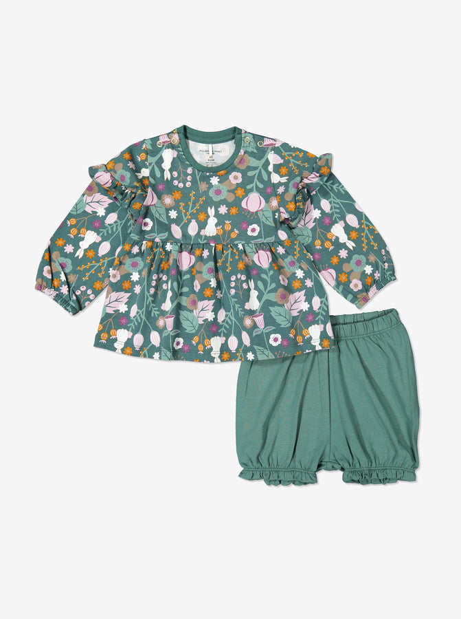 Matching set for baby girl in organic cotton comprising long sleeve top with woodland floral and bunny print. Shown with matching frilled bloomers in green.