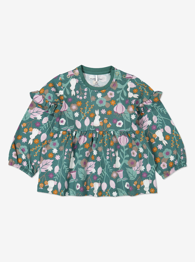 Woodland print top for baby girls with frilled shoulders, made from organic cotton fabric