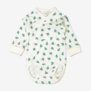 Apple print babygrow for newborn babies in a wraparound style, made from 100% organic cotton fabric