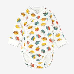 Hedghog print babygrow for newborn babies in a wraparound style, made from 100% organic cotton fabric
