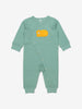 Wraparound onesie for newborn babies in GOTS organic cotton with adorable sleeping bear applique. With full length popper fastenings for speedy changes. Quality ribbed trim for added comfort.