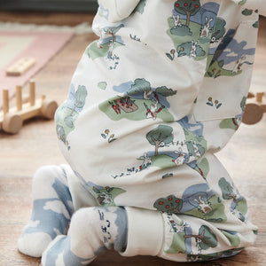 Close up of baby wearing unisex bunny print onesie in GOTS organic cotton. Paired with matching bunny print socks