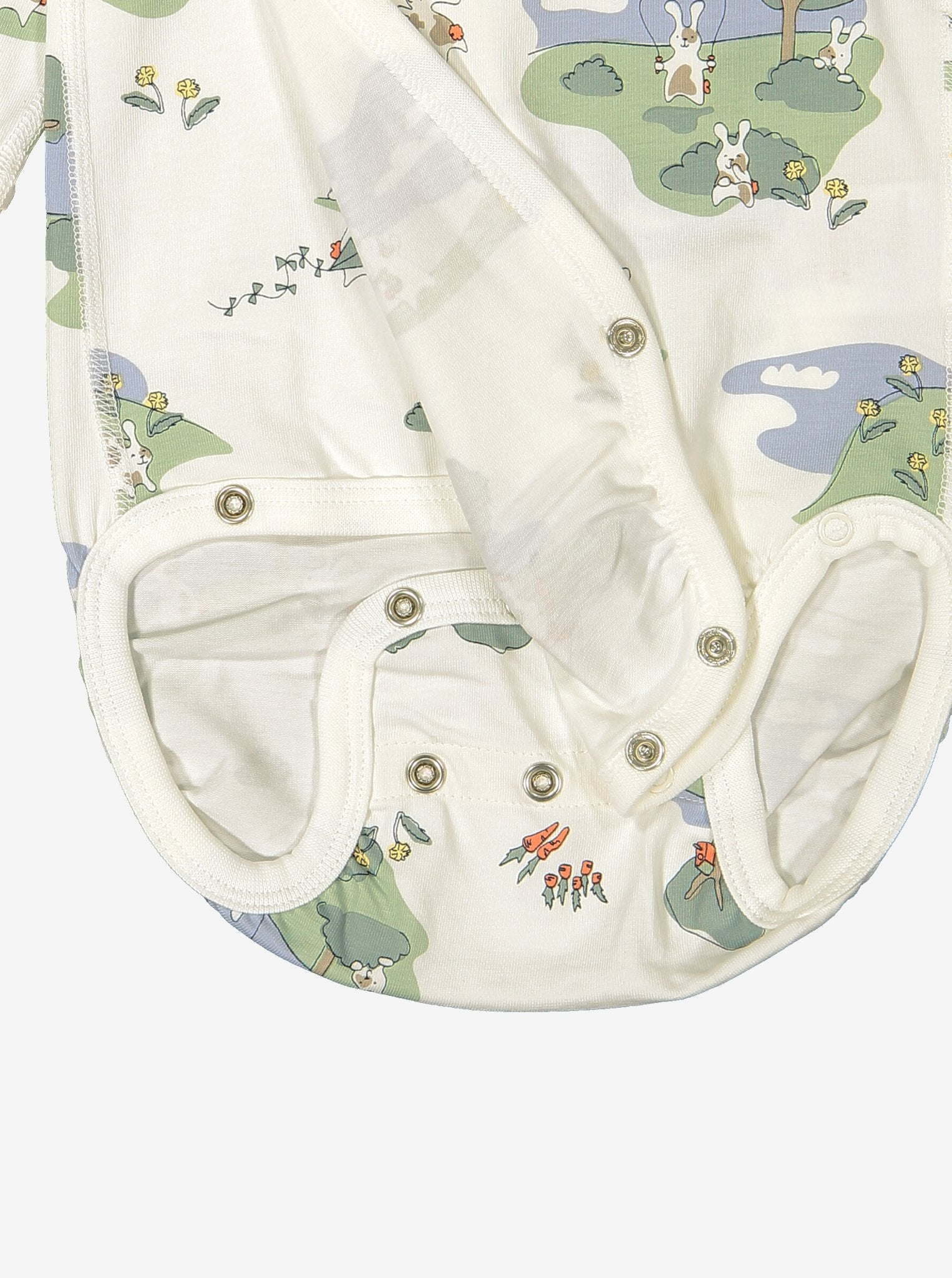 Close up of unisex bunny print wraparound organic cotton newborn babygrow showing easy popper fastening for speedy changes