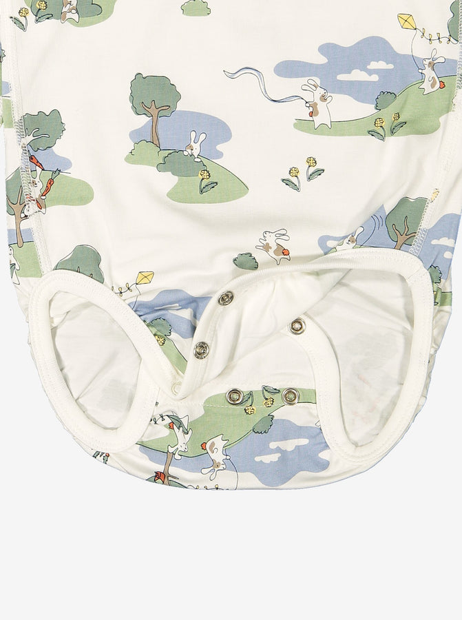 Close up of unisex bunny print GOTS organic cotton babygrow showing easy popper fastening for speedy changes