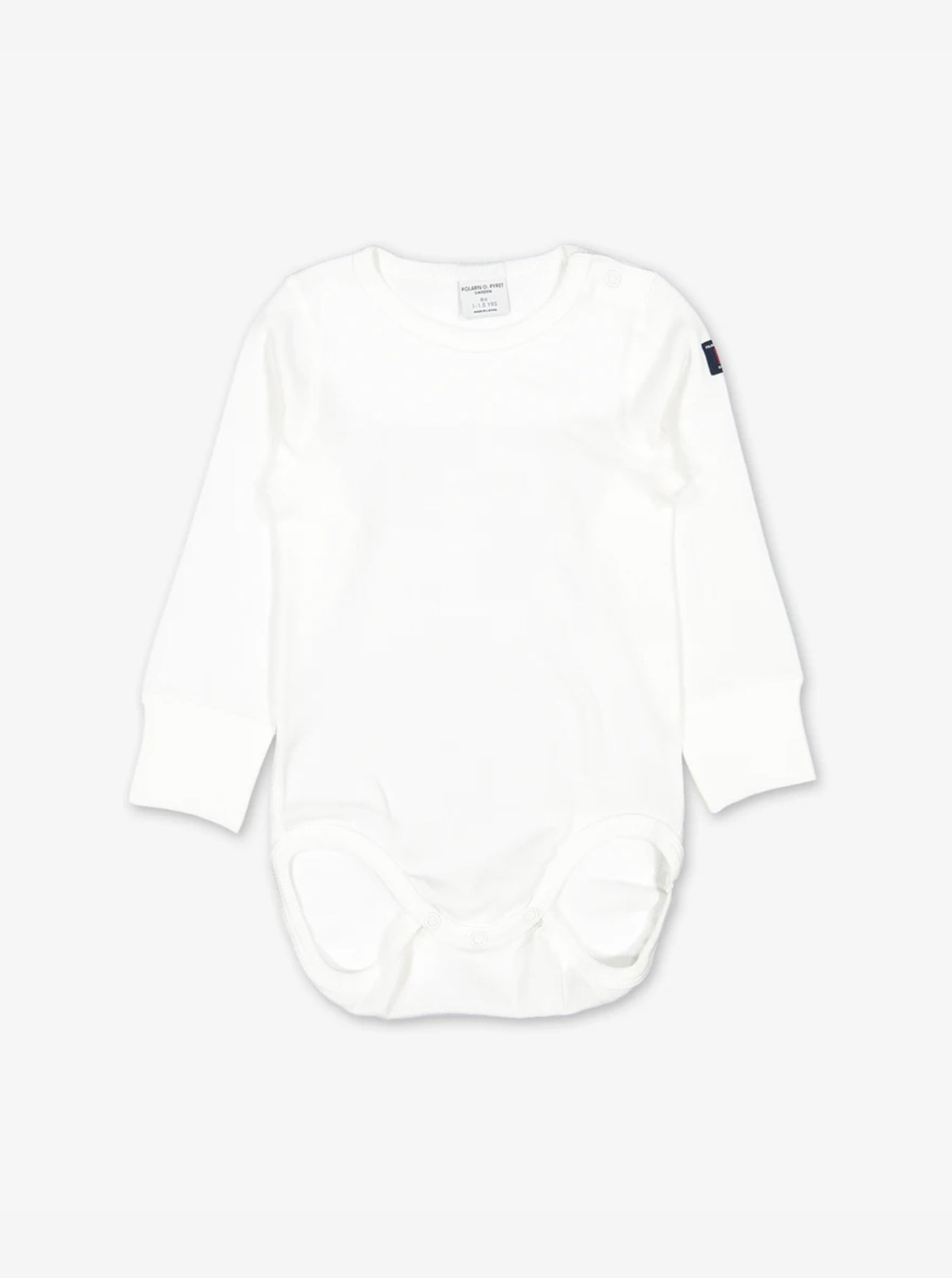 A classic white organic cotton bodysuit with long sleeves, snug leg openings and made from a super soft organic cotton fabric.