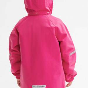 A kid wearing a pink, kids waterproof jacket, made of lightweight shell fabric, comes with reflectors and detachable hood.