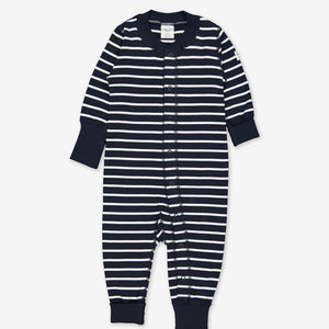 Front overall view of a navy blue and white stripe print all-in-one for newborn babies, made with certified organic cotton.