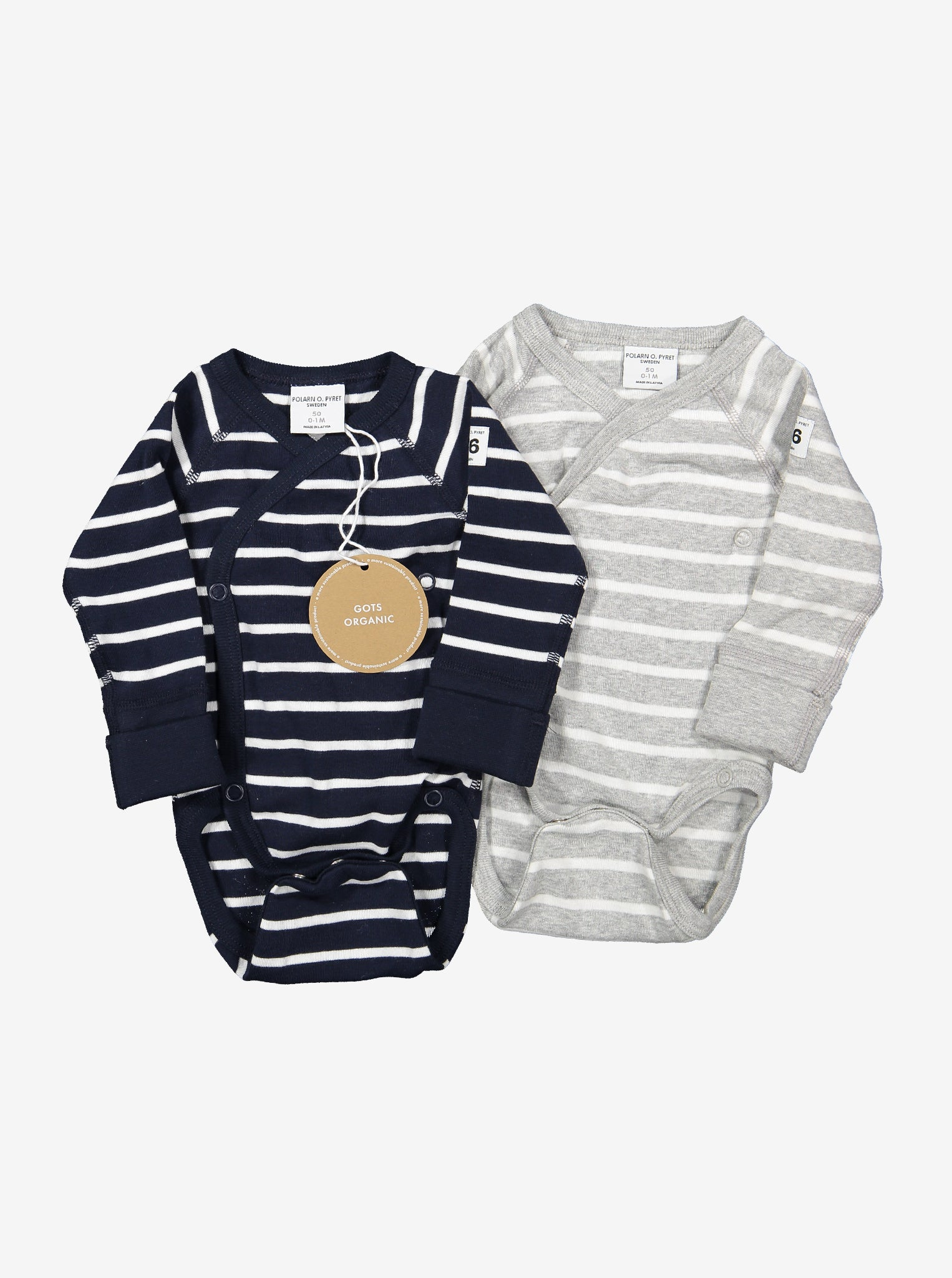 Two wraparound babygrows made from organic cotton. On the left is a navy blue & white striped babygrow, on the right is a white and grey striped babygrow.