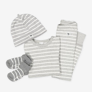 A full outfit set for babies featuring a cotton hat, a babygrow, pair of leggings and socks in a classic grey and white stripe print.