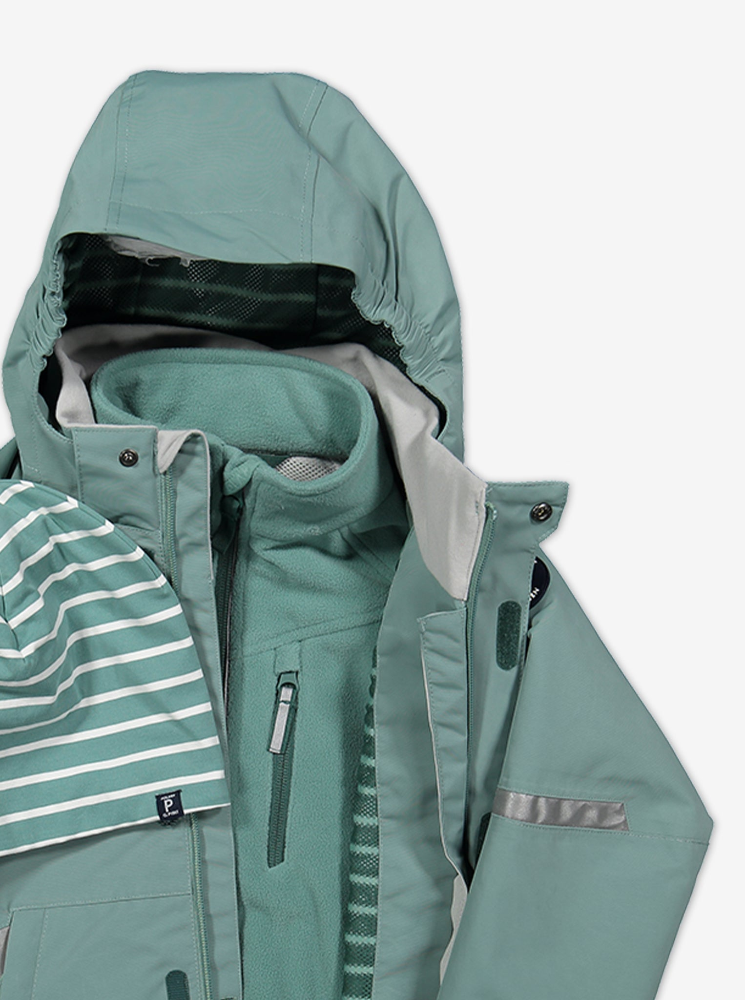 Close up view of a kids waterproof shell jacket, layered with kids waterproof fleece jacket in colour green.