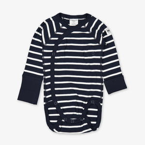 Front view of a newborn babygrow, made from organic cotton fabric in a classic navy blue and white stripes print.