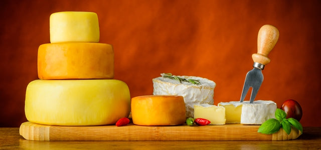 a plate with different types of cheese