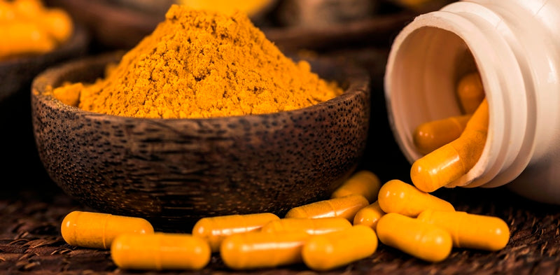 dietary supplement suggestive photo with curcumin capsules