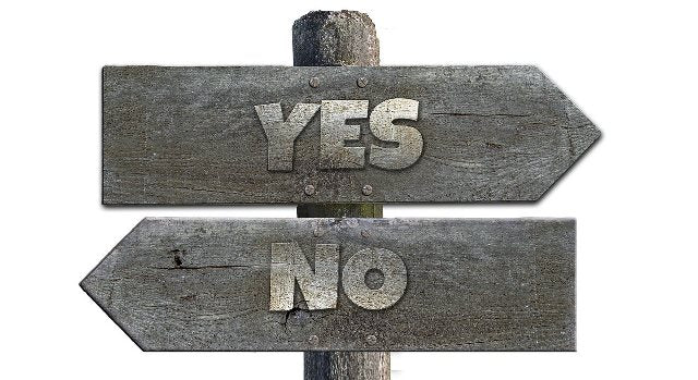 "signs with the words ""yes"" and ""no"" written on them"