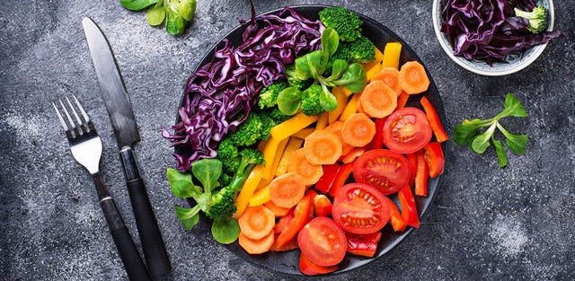 platter of salad with rainbow colored vegetables