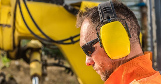 construction worker with hearing protection headphones