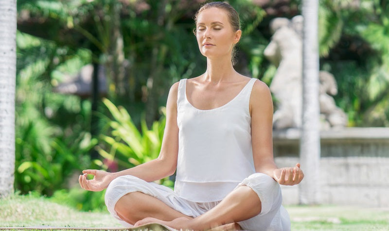 calm woman meditating