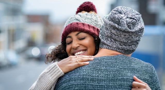 happy woman hugging someone