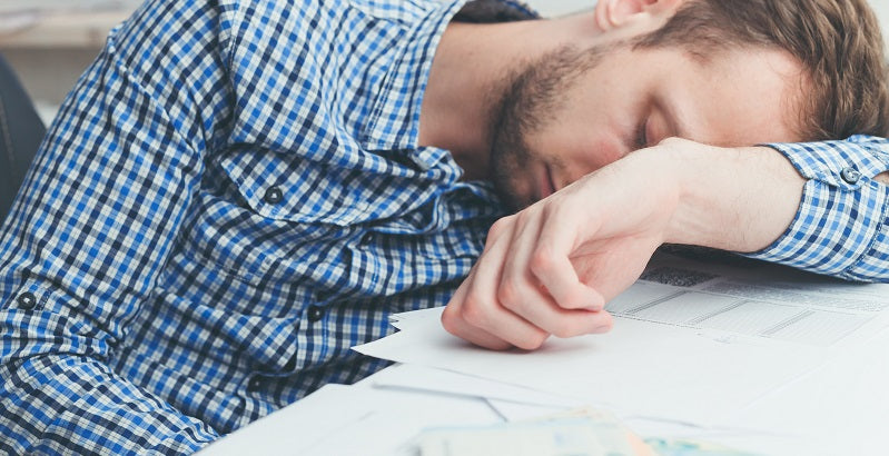 exhausted man at work - chronic fatigue
