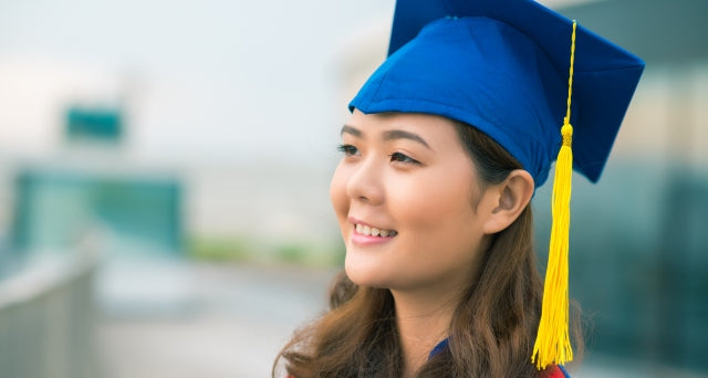 girl with graduation cap smiling