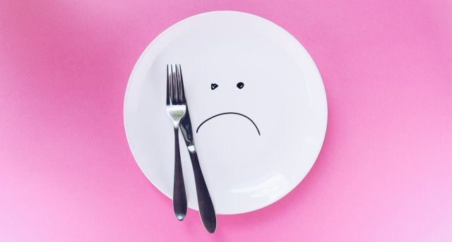 plate with sad face drawn on it