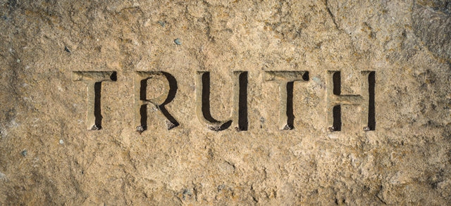 "the word ""truth"" chiseled in stone"