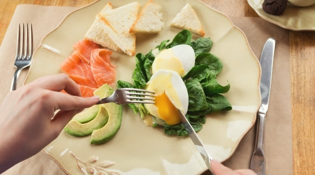 healthy breakfast with eggs, avocado, and salmon