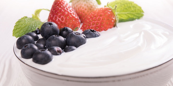 bowl of yogurt with berries and mint on top