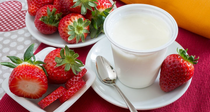 cup of yogurt with strawberries
