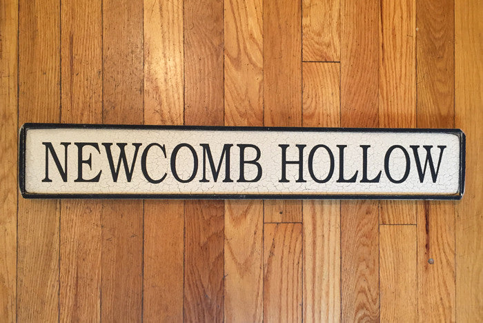 NEWCOMB HOLLOW SIGN