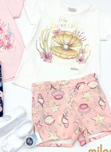 Milon Girls White Tee with gold clam paired with pink matching printed shorts