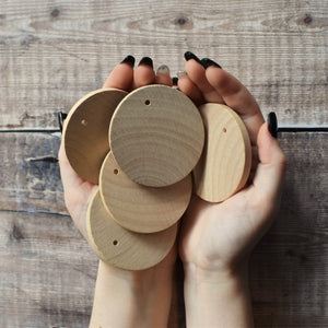 Five 6cm diameter unpainted wooden disc decorations