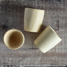 Load image into Gallery viewer, Egg cups - solid wooden beech beaker shape outside, egg shape indent inside